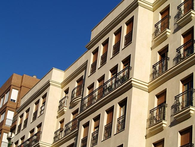 Madrid Spain, facade coating with caramel limestone