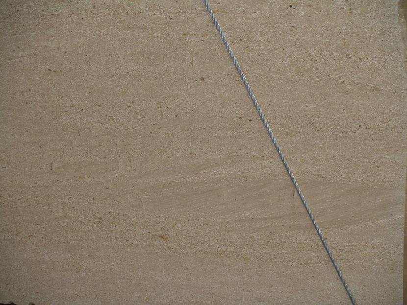 Particular picture of a caramel limestone slab