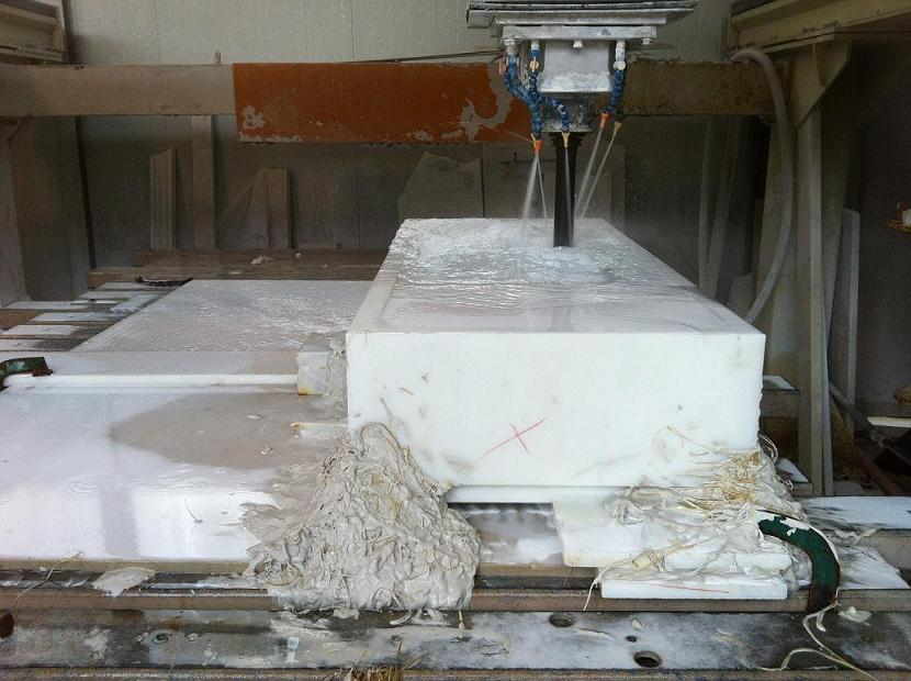 Numerical control machine to making a hole in a block of statuary marble to make a solid sinks